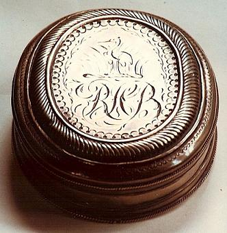 A silver snuff box which originally belonged to Thomas Harris of Canterbury. It came down through the Barham  family to Richard Harris Barham, who had his crest engraved on one side of it.